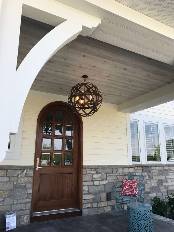Beautiful rounded door paired with barnwood porch ceiling [Easy Barnwood Collection from Great American Spaces]