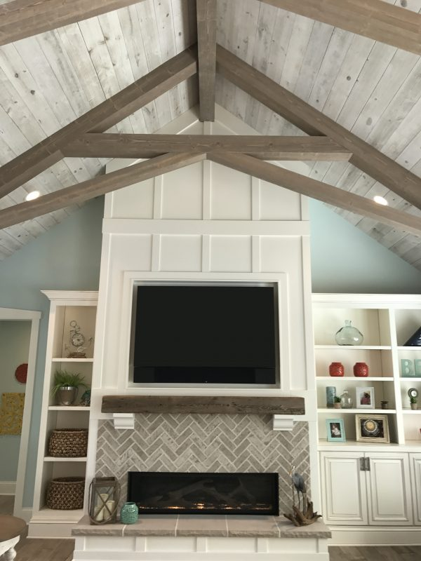 Vaulted ceiling in living room with wood paneling and exposed beams [Easy Barnwood Collection from Great American Spaces]