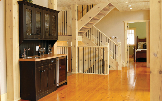 Modern log cabin look with pine staircase [ClassicPine Collection from Great American Spaces]