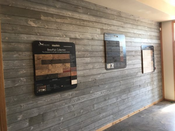 Dealer show room display wall using Great American Spaces ShipLap in Gray Sky from MidAm Springhill